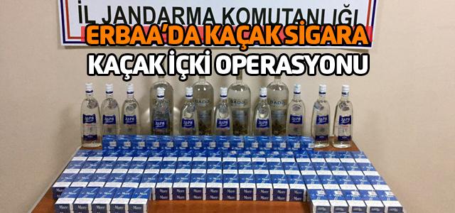 Azeri yolcunun valizinden 180 paket sigara, 12 litre içki çıktı