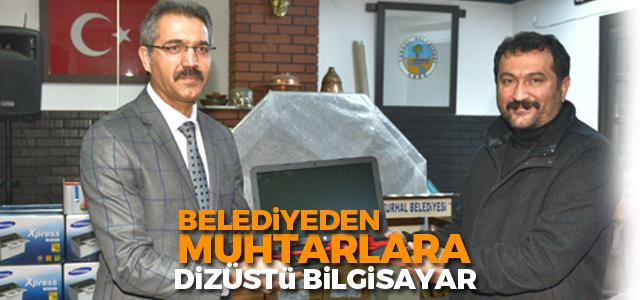 Turhal'da mahalle muhtarlarına dizüstü bilgisayar hediye edildi